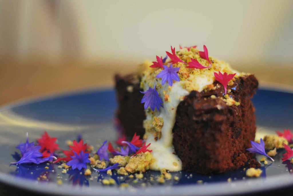 Chocolate cake with edible flowers on top