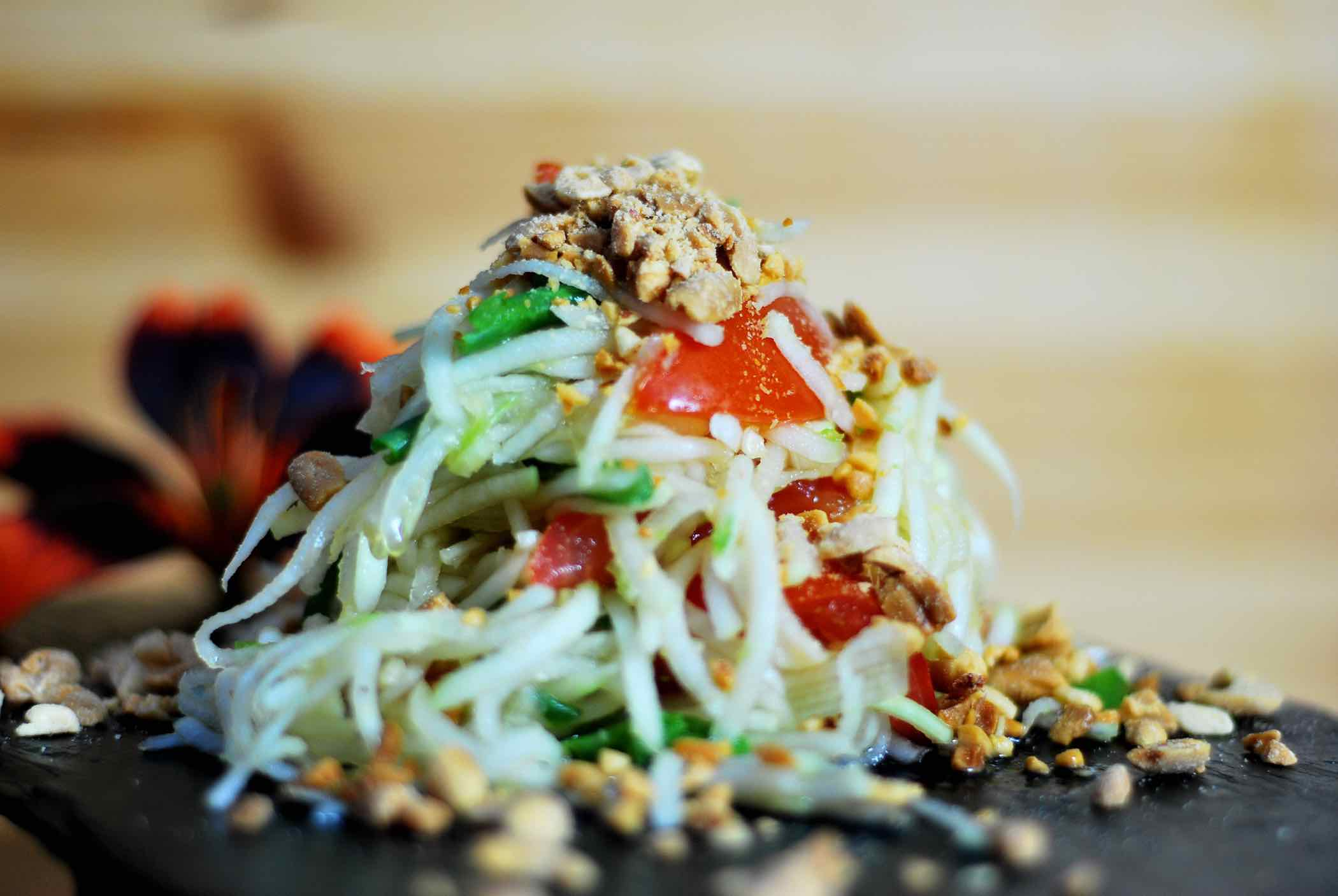 Papaya salad topped with peanuts