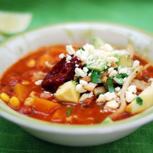 Tortilla soup with avocado and coriander