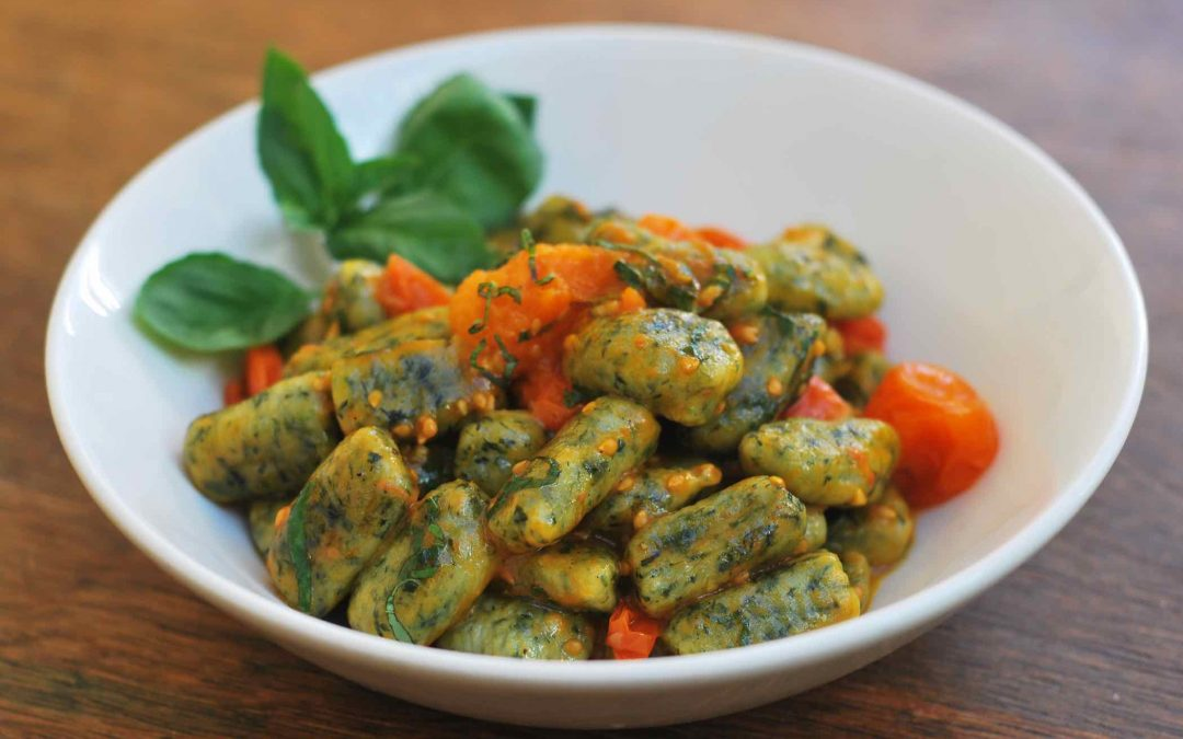 Spinach gnocchi with cherry tomato ragù