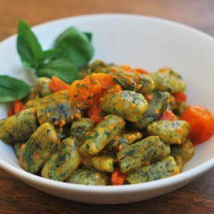 Spinach gnocchi with cherry tomato ragù