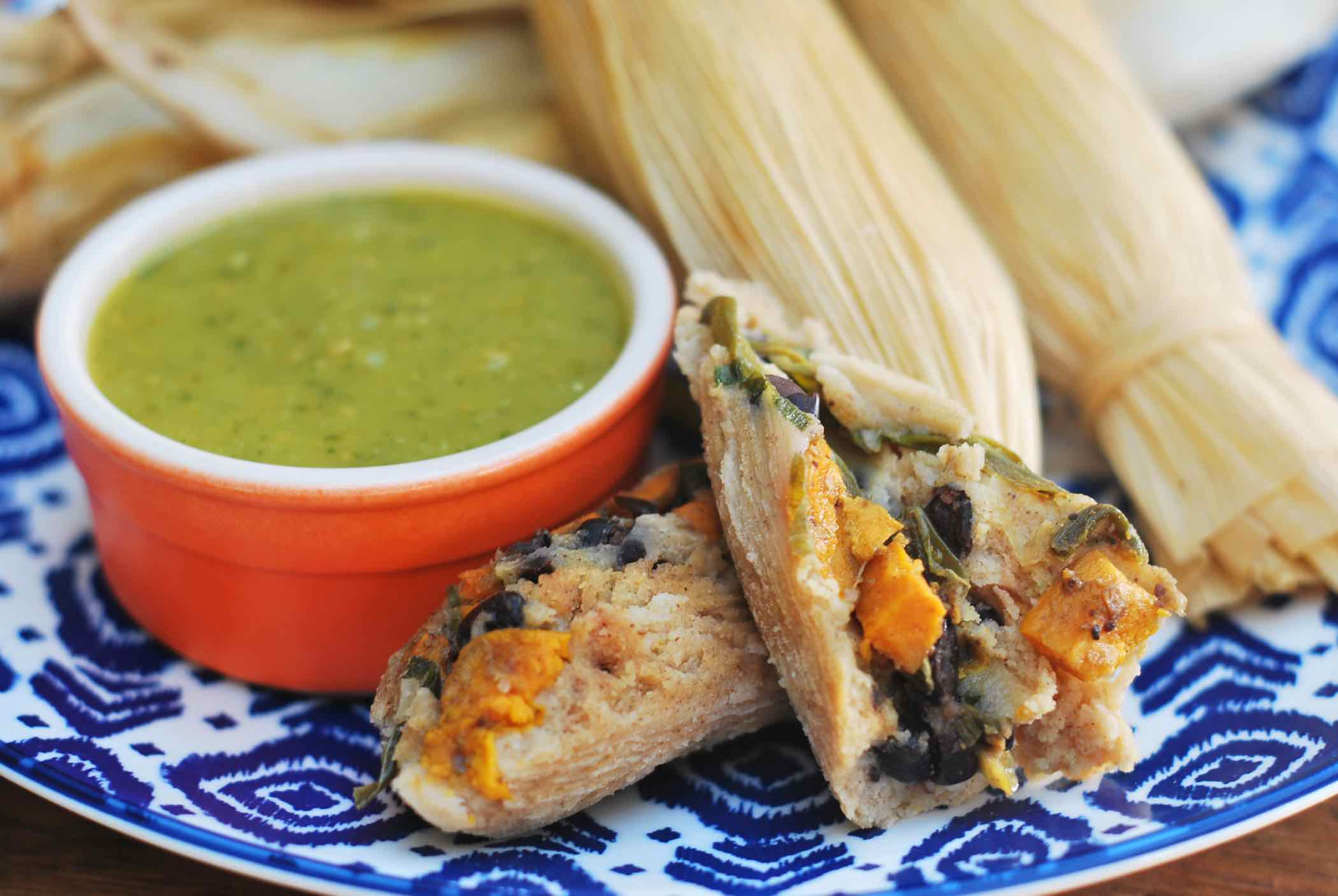 Tamales with sweet potato and black beans, with a green sauce