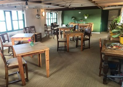 Natural Cookery School Bistro with socially-distanced tables